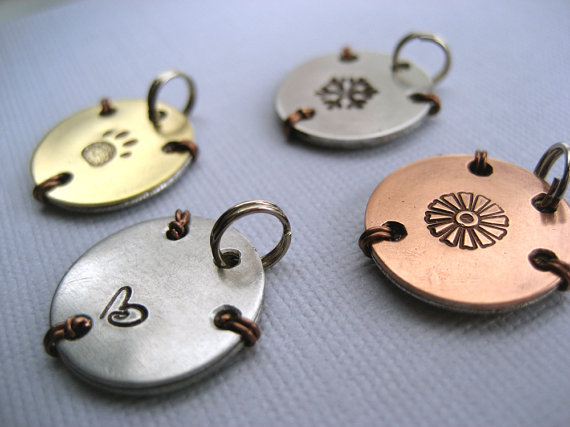 Finished charms-tiny swirl heart is stamped on the back